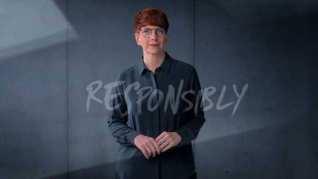 SCHOTT employee in gray clothing on a gray background